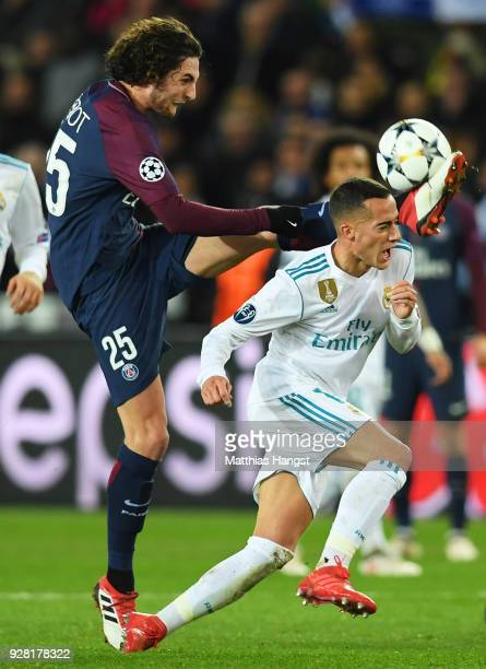 Lucas Vazquez of Real Madrid is challenged by Adrien Rabiot of PSG during the UEFA Champions League Round of 16 Second Leg match between Paris...