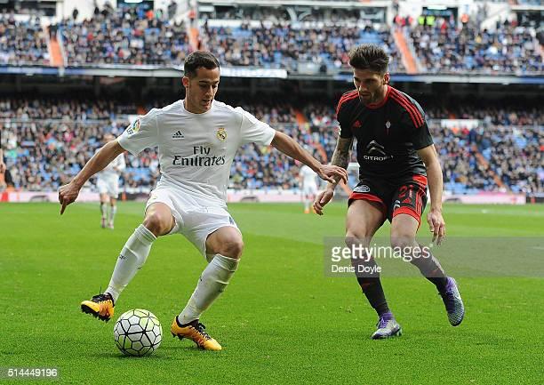 Lucas Vazquez of Real Madrid is challenged by Carles Planas of Celta Vigo during the La Liga match between Real Madrid CF and Celta Vigo at Estadio...