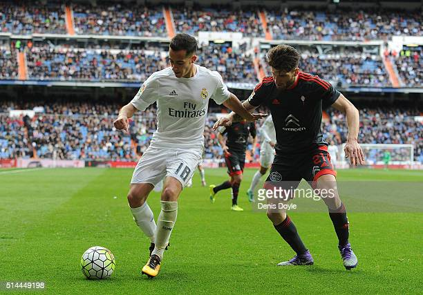 Lucas Vazquez of Real Madrid is challenged by Carles Planas of Celta Vigo during the La Liga match between Real Madrid CF and Celta Vigo at Estadio...