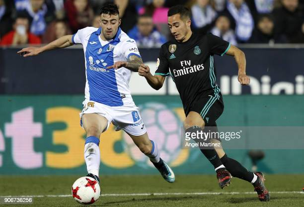 Lucas Vazquez of Real Madrid is challenged by Diego Rico of Leganes during the Spanish Copa del Rey Quarter Final First Leg match between Leganes and...