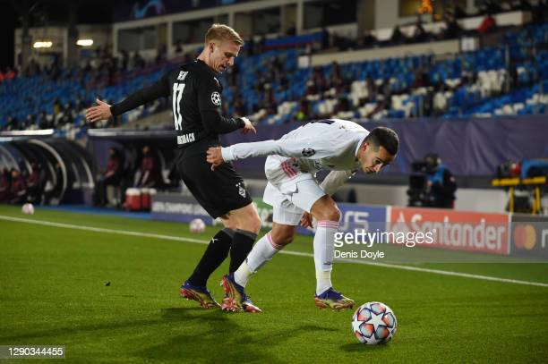 Lucas Vazquez of Real Madrid is challenged by Oscar Wendt of Borussia Monchengladbach during the UEFA Champions League Group B stage match between...