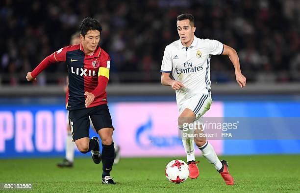 Lucas Vazquez of Real Madrid is closed down by Shuto Yamamoto of Kashima Antlers during the FIFA Club World Cup Final match between Real Madrid and...