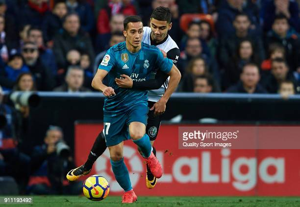 Lucas Vazquez of Real Madrid is tackled by Andreas Pereira of Valencia during the La Liga match between Valencia and Real Madrid at Estadio Mestalla...