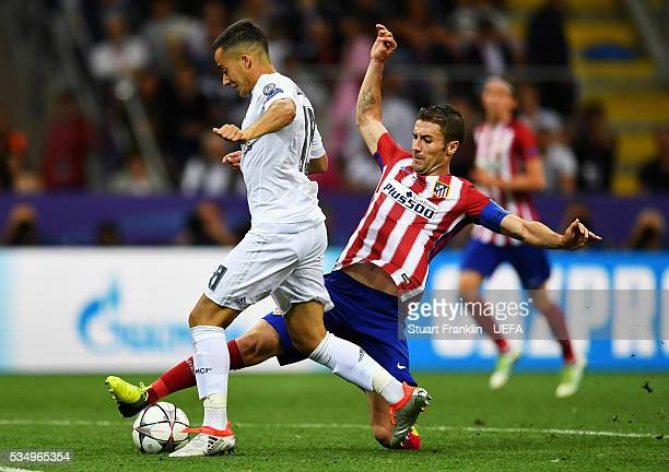 Lucas Vazquez of Real Madrid is tackled by Gabi of Atletico Madrid during the UEFA Champions League Final between Real Madrid and Club Atletico de...