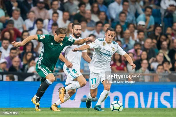 Lucas Vazquez of Real Madrid is tackled by Joaquin Sanchez Rodriguez of Real Betis during the La Liga 201718 match between Real Madrid and Real Betis...