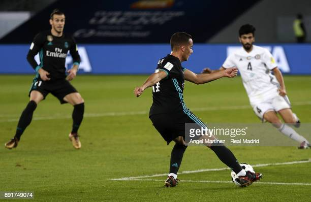 Lucas Vazquez of Real Madrid passes the ball to Gareth Bale during the FIFA Club World Cup UAE 2017 semifinal match between Al Jazira and Real Madrid...