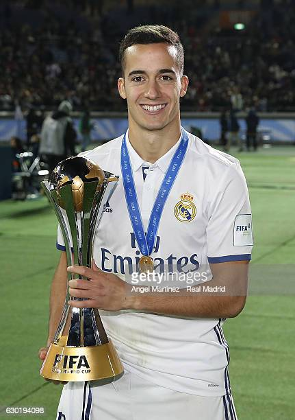 Lucas Vazquez of Real Madrid poses with the trophy after the FIFA Club World Cup Final match between Real Madrid and Kashima Antlers at International...