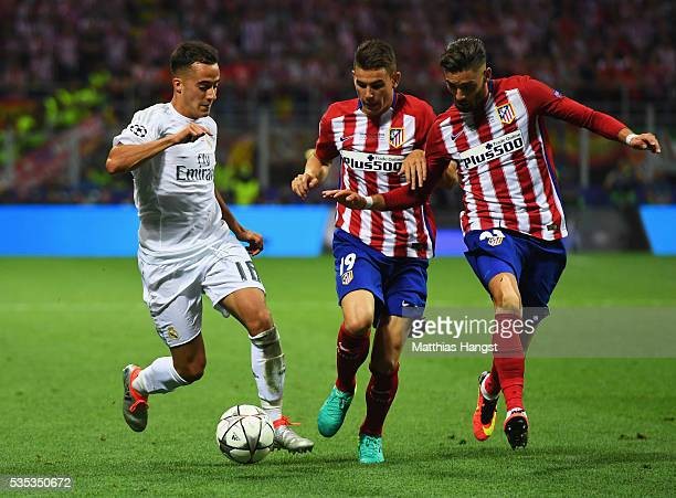 Lucas Vazquez of Real Madrid takes on Lucas Hernandez and Yannick Carrasco of Atletico Madrid during the UEFA Champions League Final match between...