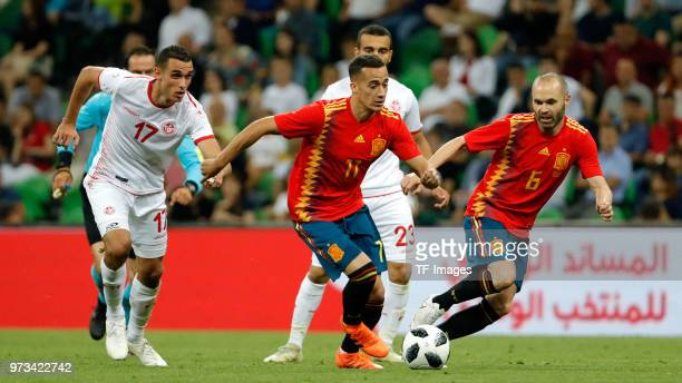 Lucas Vazquez of Spain and Andres Iniesta of Spain and Ellyes Skhiri of Tunisia battle for the ball during the friendly match between Spain and...