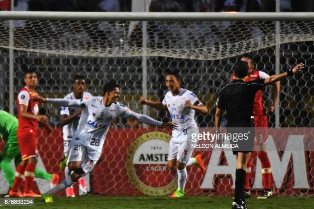 Lucas Verissimo of Brazils Santos celebrates his goal scored against Colombias Santa Fe during their 2017 Copa Libertadores football match held at...