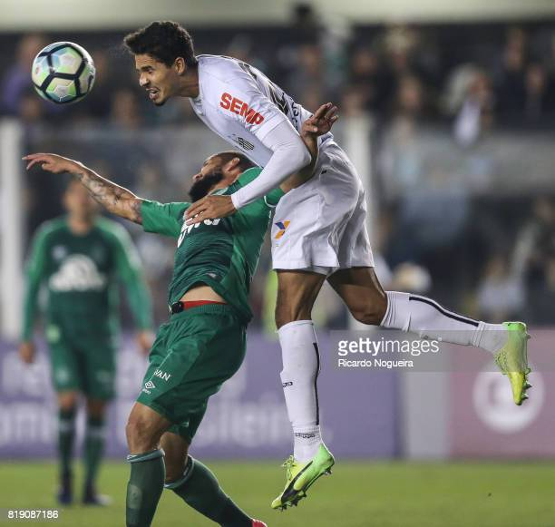 Lucas Verissimo of Santos battles for the ball with Fabricio Bruno of Chapecoense during the match between Santos and Chapecoense as a part of...