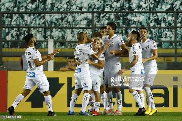 Lucas Verissimo of Santos celebrates with teammates after scoring the first goal of his team during a Group G match between Santos and Delfin as part...
