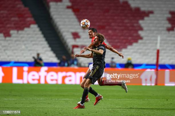 Lucas Veríssimo of SL Benfica higher that Thomas Muller of FC Bayern Munchen heads the ball during the UEFA Champions League group E match between SL...