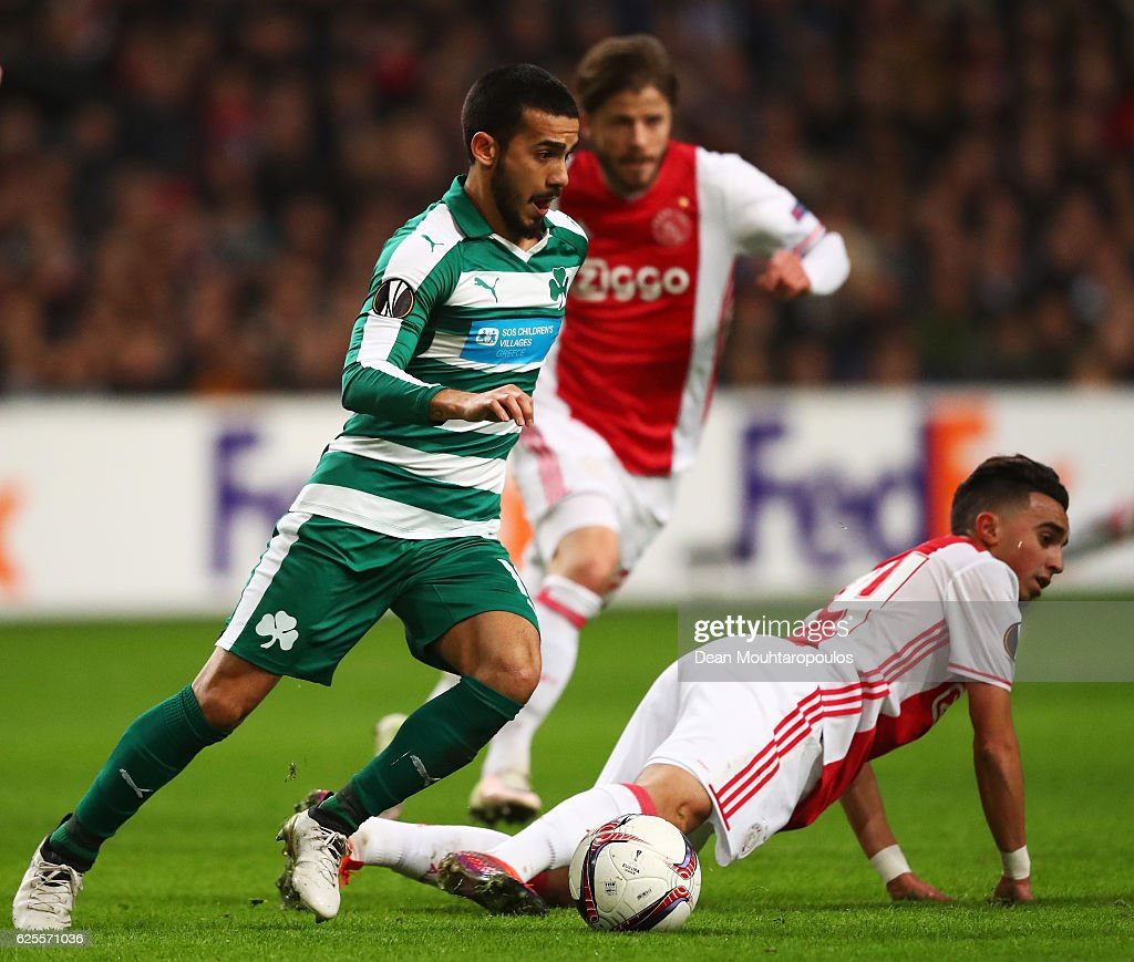 Lucas Villafanez of Panathinaikos evades Abdelhak Nouri of Ajax during the UEFA Europa League Group G match between AFC Ajax and Panathinaikos FC at Amsterdam Arena on November 24, 2016 in Amsterdam, Netherlands.