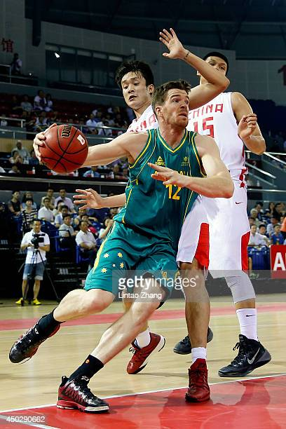 Lucas Walker of Australia looks to pass against Ding Yanyuhang and Xu Zhonghao of China during the 2014 SinoAustralia Men's International Basketball...