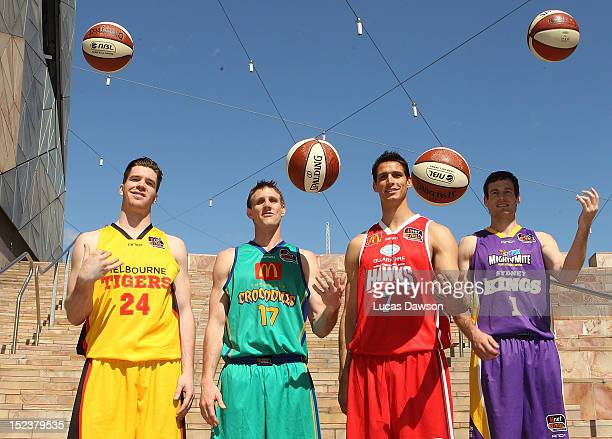 Lucas Walker of the Melbourne Tigers and Peter Crawford of the Townsville Crocodiles and Oscar Forman of the Wollongong Hawks and Ben Madgen of the...