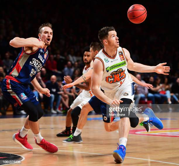 Lucas Walker of the Taipans fumbles the ball in front of Anthony Drmic of the Adelaide 36ers during the round seven NBL match between the Adelaide...
