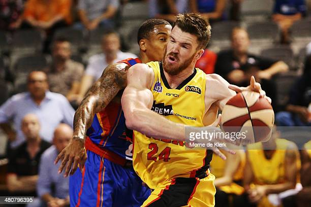 Lucas Walker of the Tigers bumps into Gary Ervin of the 36ers during game one of the NBL Semi Final series between the Adelaide 36ers and the...
