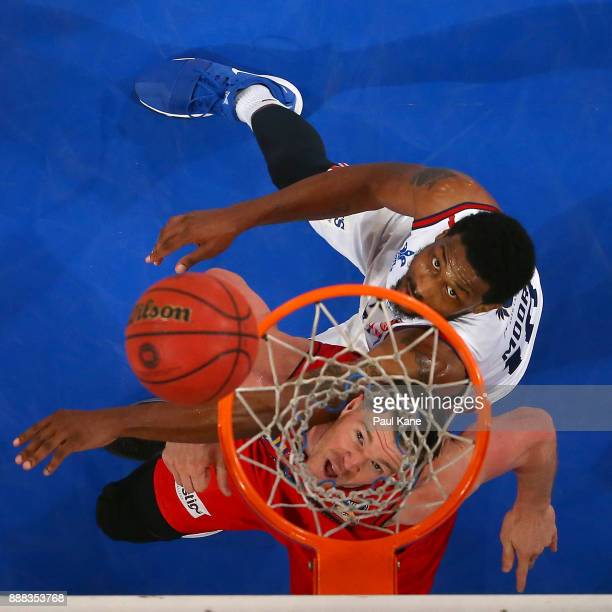 Lucas Walker of the Wildcats and Ramone Moore of the 36ers contest for a rebound during the round nine NBL match between the Perth Wildcats and the...