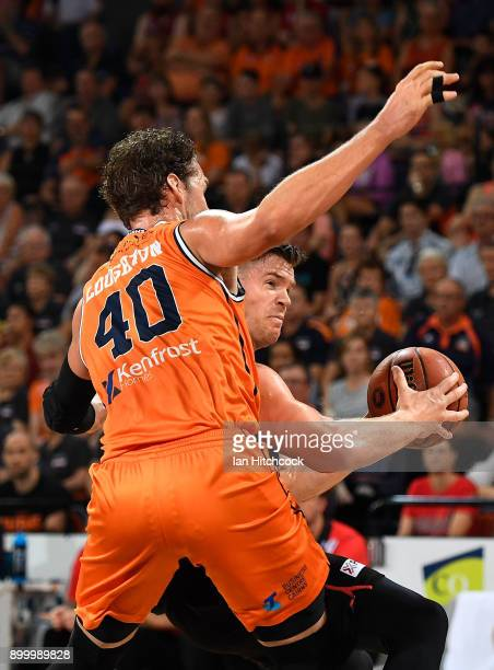 Lucas Walker of the Wildcats drives into Alex Loughton of the Taipans during the round 12 NBL match between the Cairns Taipans and the Perth Wildcats...