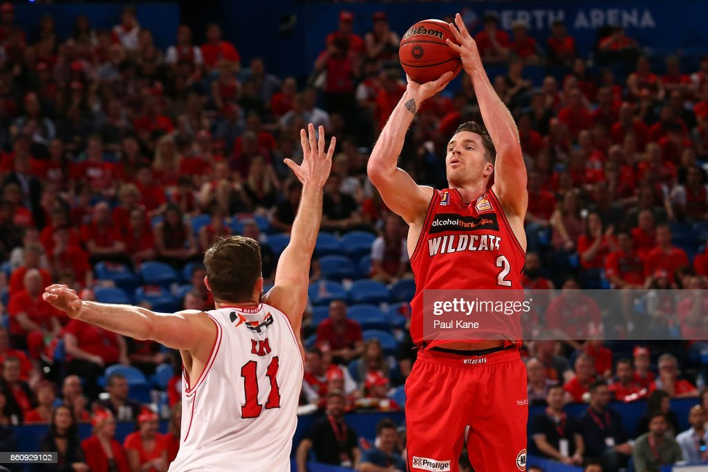 Lucas Walker of the Wildcats puts a shot up against Nicholas Kay of the Hawks during the round two NBL match between the Perth Wildcats and the Illawarra Hawks at Perth Arena on October 13, 2017 in Perth, Australia.