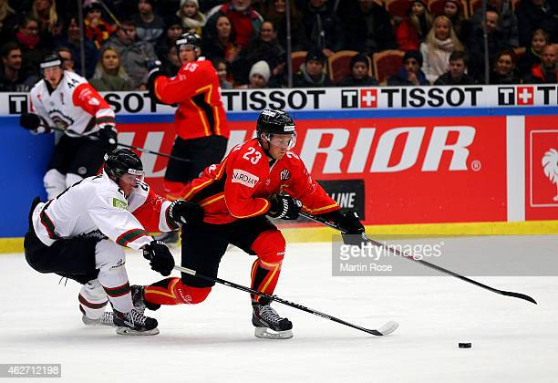 Lucas Wallmark of Lulea battles for the puck with Erik Karlsson of Gothenburg during the Champions Hockey League final match at Coop Norrbotten Arena...