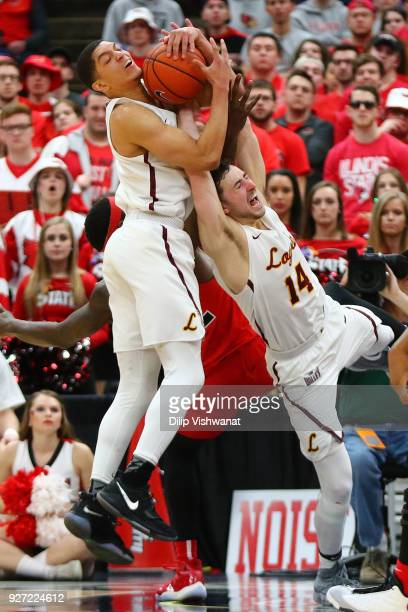 Lucas Williamson and Ben Richardson of the Loyola Ramblers pull down a rebound against the Illinois State Redbirds during the Missouri Valley...