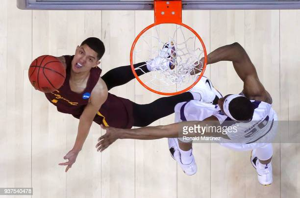 Lucas Williamson of the Loyola Ramblers shoots against Xavier Sneed of the Kansas State Wildcats in the second half during the 2018 NCAA Men's...