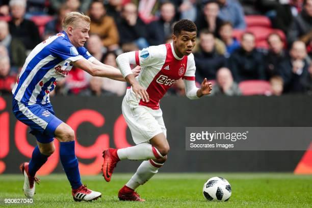 Lucas Woudenberg of SC Heerenveen David Neres of Ajax during the Dutch Eredivisie match between Ajax v SC Heerenveen at the Johan Cruijff Arena on...