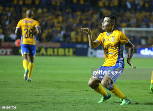 Lucas Zelarayan celebrates after scoring his team's first goal the semi finals first leg match between Tigres UANL and Tijuana as part of the Torneo...