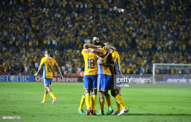 Lucas Zelarayan celebrates with teammates after scoring his team's first goal the semi finals first leg match between Tigres UANL and Tijuana as part...