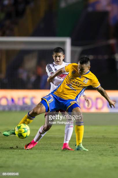 Lucas Zelarayan of Tigres fights for the ball with Carlos Vargas of Tijuana during the semi finals first leg match between Tigres UANL and Tijuana as...