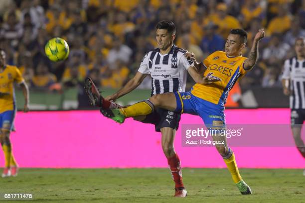 Lucas Zelarayan of Tigres fights for the ball with Jesus Molina of Monterrey during the quarter finals first leg match between Tigres UANL and...