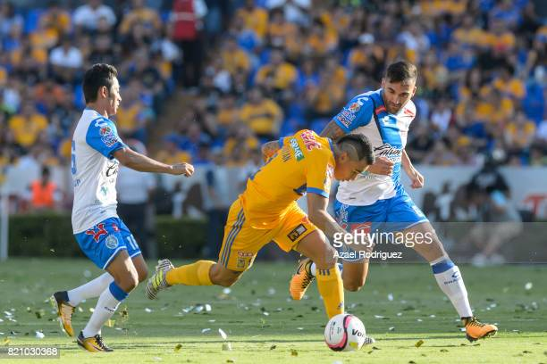 Lucas Zelarayan of Tigres fights for the ball with Jose Toledo and Pablo Miguez of Puebla during the 1st round match between Tigres UANL and Puebla...