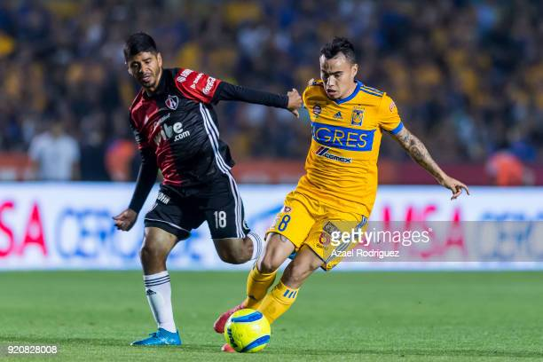 Lucas Zelarayan of Tigres fights for the ball with Luis Robles of Atlas during the 8th round match between Tigres UANL and Atlas as part of the...