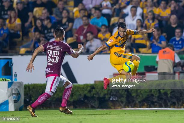 Lucas Zelarayan of Tigres fights for the ball with Mario Osuna of Morelia during the 9th round match between Tigres UANL and Morelia as part of the...