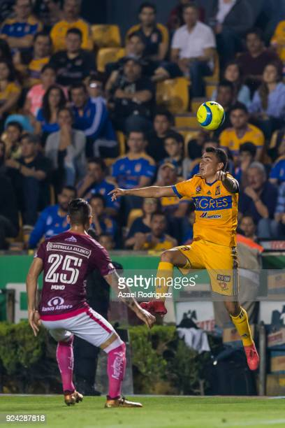 Lucas Zelarayan of Tigres heads the ball while observed by Mario Osuna of Morelia during the 9th round match between Tigres UANL and Morelia as part...