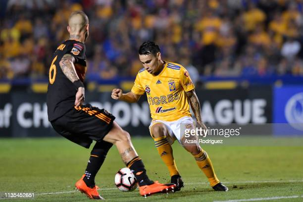 Lucas Zelarayán of Tigres fights for the ball with Aljaz Struna of Houston Dynamo during the match between Tigres UANL and Houston Dynamo as part of...