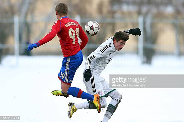 Lucas-Julian Scholl of Bayern Muenchen battles for the ball with Maksim Martusevic of Moscow during the UEFA Youth League match between CSKA MOscow...