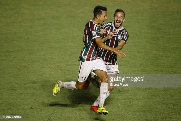 Lucca of Fluminense celebrates with team mate Yago Felipe after scoring the first goal of his team during the match between Fluminense and Botafogo...