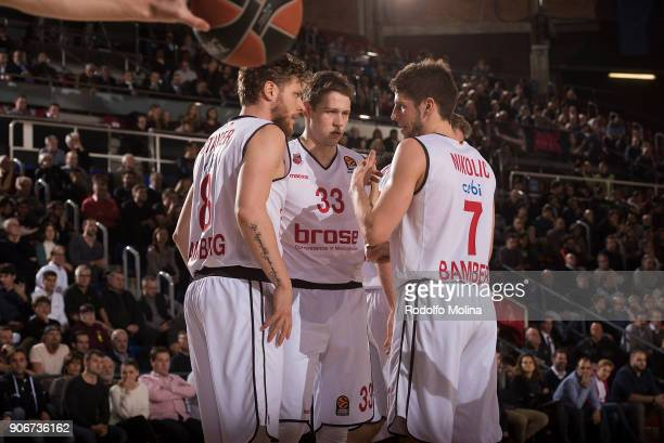 Lucca Staiger #8 of Brose Bamberg Patrick Heckmann #33 and Aleksej Nikolic #7 during the 2017/2018 Turkish Airlines EuroLeague Regular Season Round...
