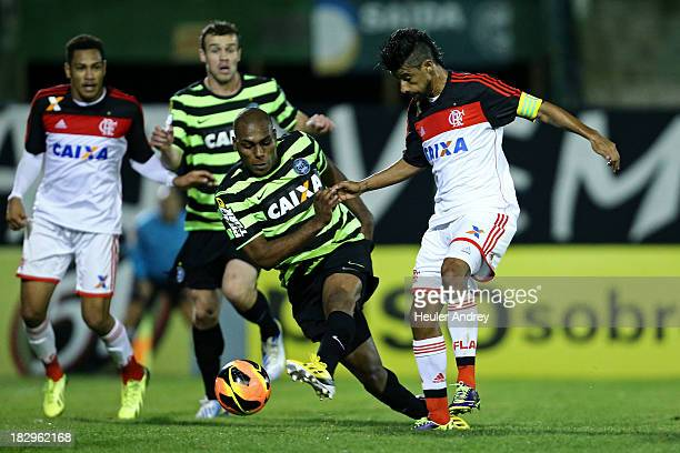 Luccas Claro of Coritiba fights for the ball with Leo Moura of Flamengo during the match betweenCoritiba and Flamengofor the Brazilian Serie A 2013...