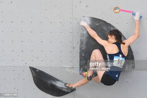 Luce Douady controls a hold for points during the IFSC Climbing Vail World Cup on June 8 in Vail Colorado