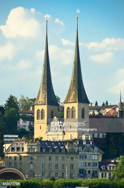 Lucerne cityscape at sunset with St. Leodegar church and its romanesque spires, Switzerland