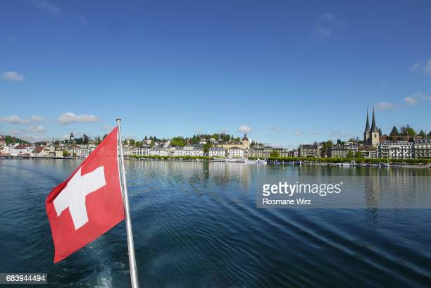 Lucerne cityscape seen from lake with Swiss flag