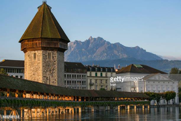 Lucerne Switzerland Reuss Chapel bridge at dawn with Mount Pilatus