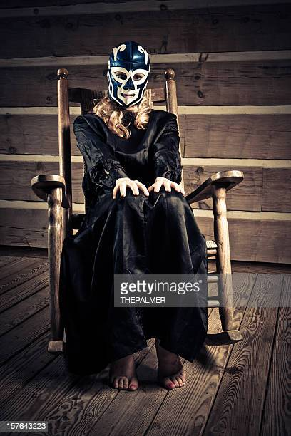 lucha libre wrestler wife waiting in the porch - rough housing stock photos and pictures