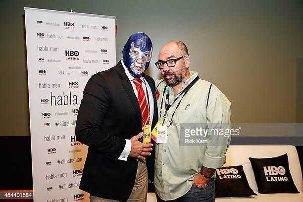Luchador Blue Demon Jr and director Alberto Ferreras pose for a photograph during HBO Latino Habla Men at People en Español San Antonio Festival at...