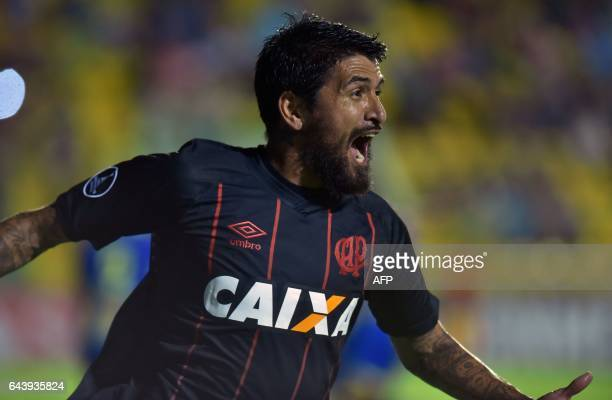 Lucho Gonzalez of Brazil's Atletico Paranaense celebrates the goal he scored against Paraguay's Deportivo Capiata during their Libertadores Cup...