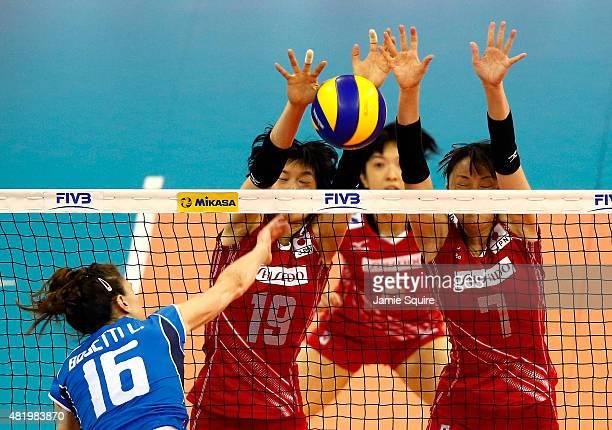 Lucia Bosetti of Italy spikes the ball as Haruka Miyashita Mai Yamaguchi and Chizuru Koto of Japan defend during day 4 of the FIVB Volleyball World...